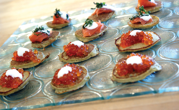 Corn blinis with smoked salmon and salmon caviar. Photos by Dan Kacvinski